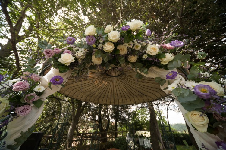 Colorful floweres decoration at a wedding in the garden in rome