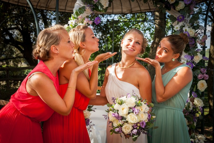 newly married Bride and her Bridesmaid at a wedding in the Garden in Rome Italy