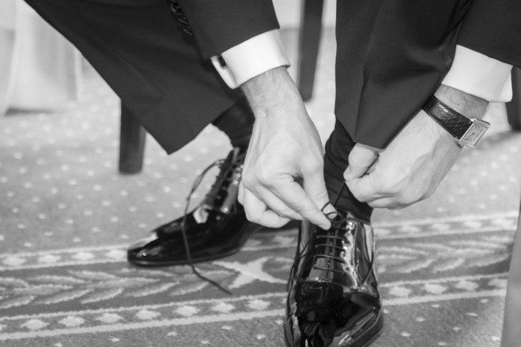 Groom tighting the shoelace